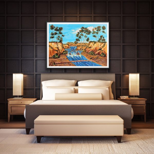 Over sized giclee of a rushing river past eucalyptus bluffs over a bed