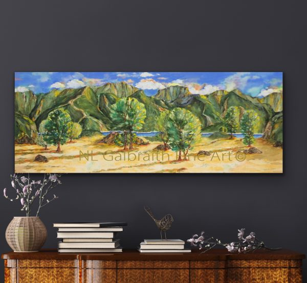 Oversized landscape of a mountainous waterfront field over an office credenza