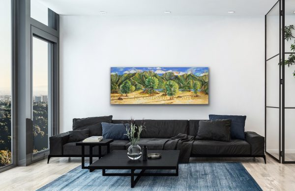 Long giclee of a mountainous waterfront clearing over a black sofa