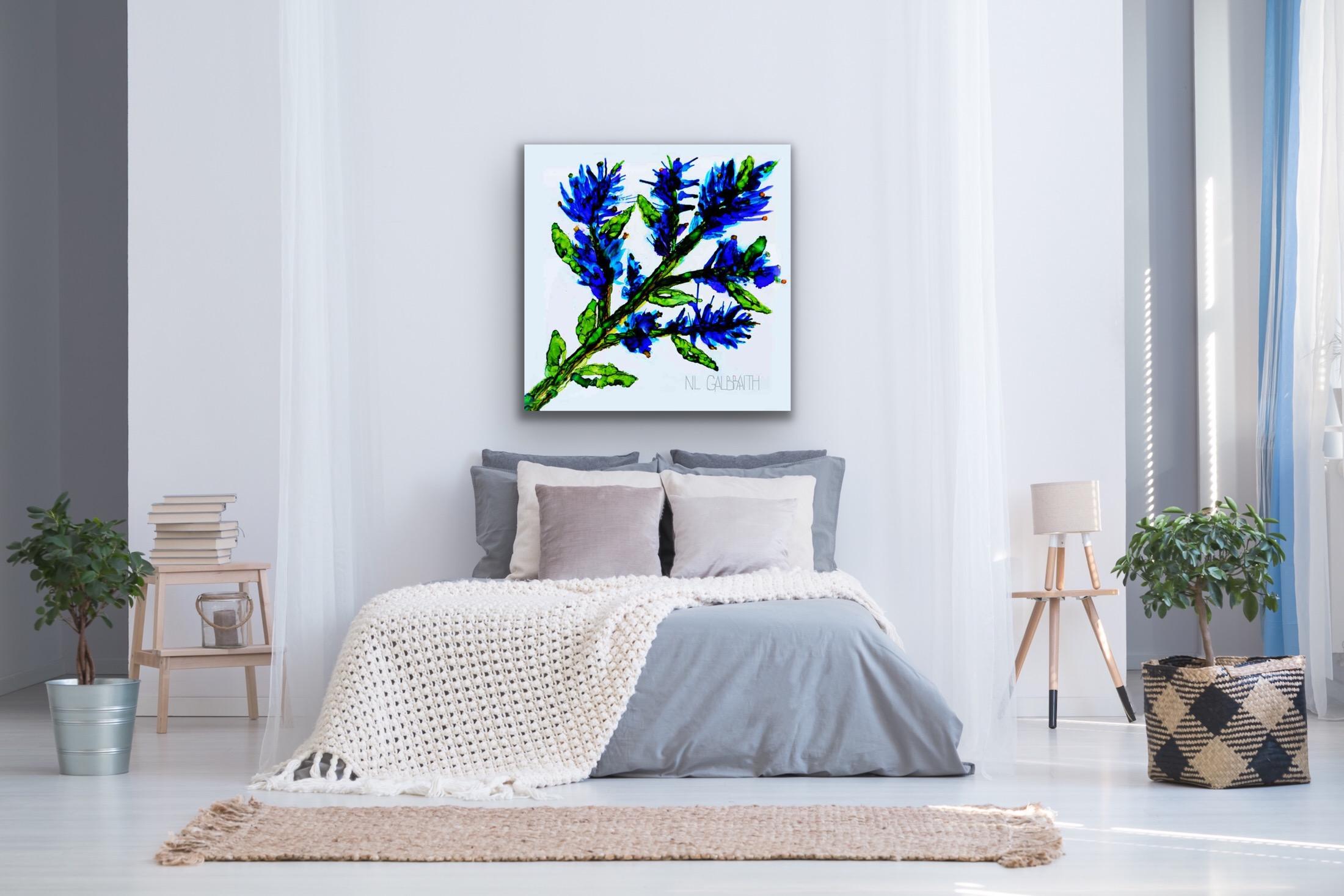 Large Blue Sprig Flower Graphic Over a Blue Bed