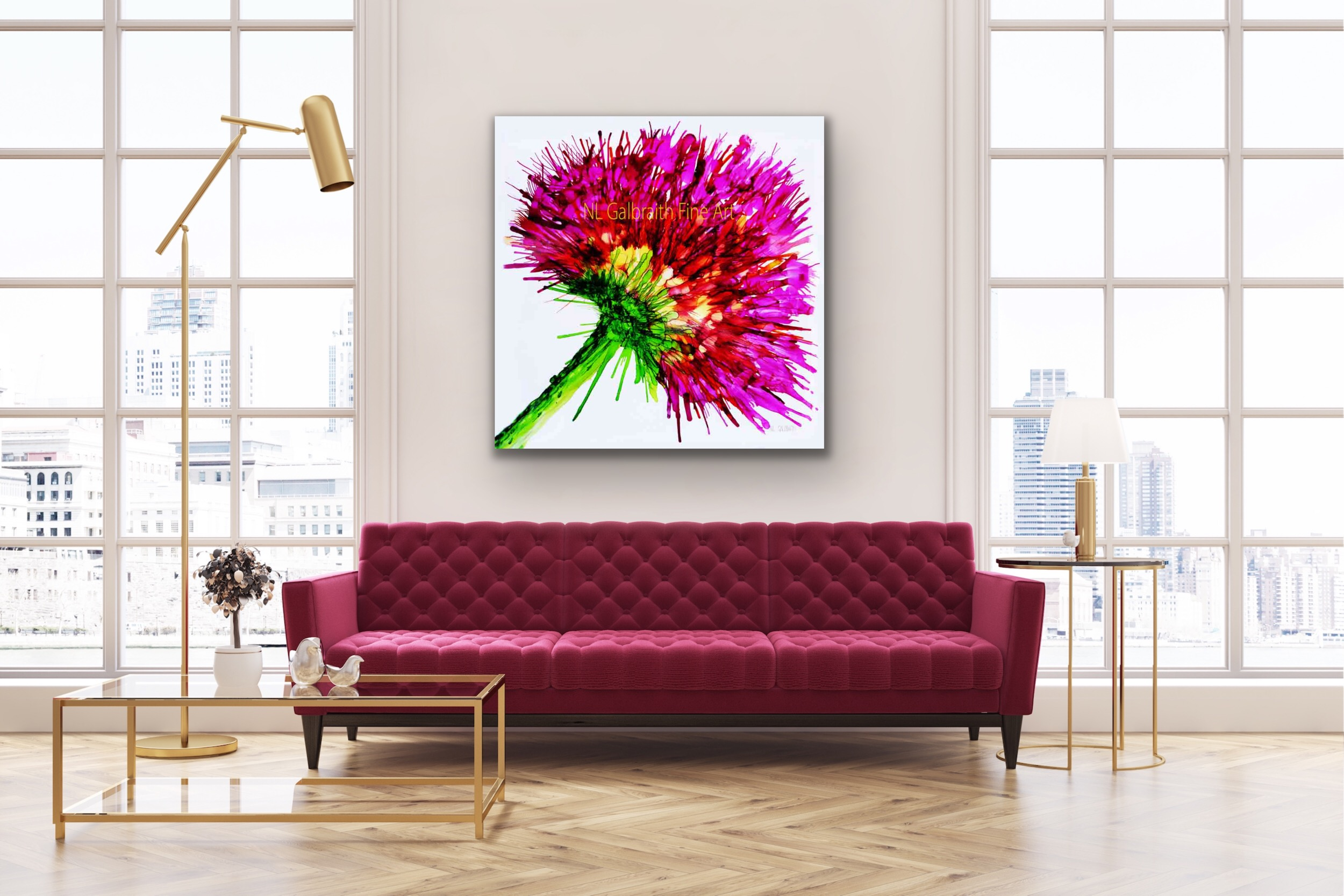 Graphic of a Pink Flower Over a Plum Colored Sofa in a Loft