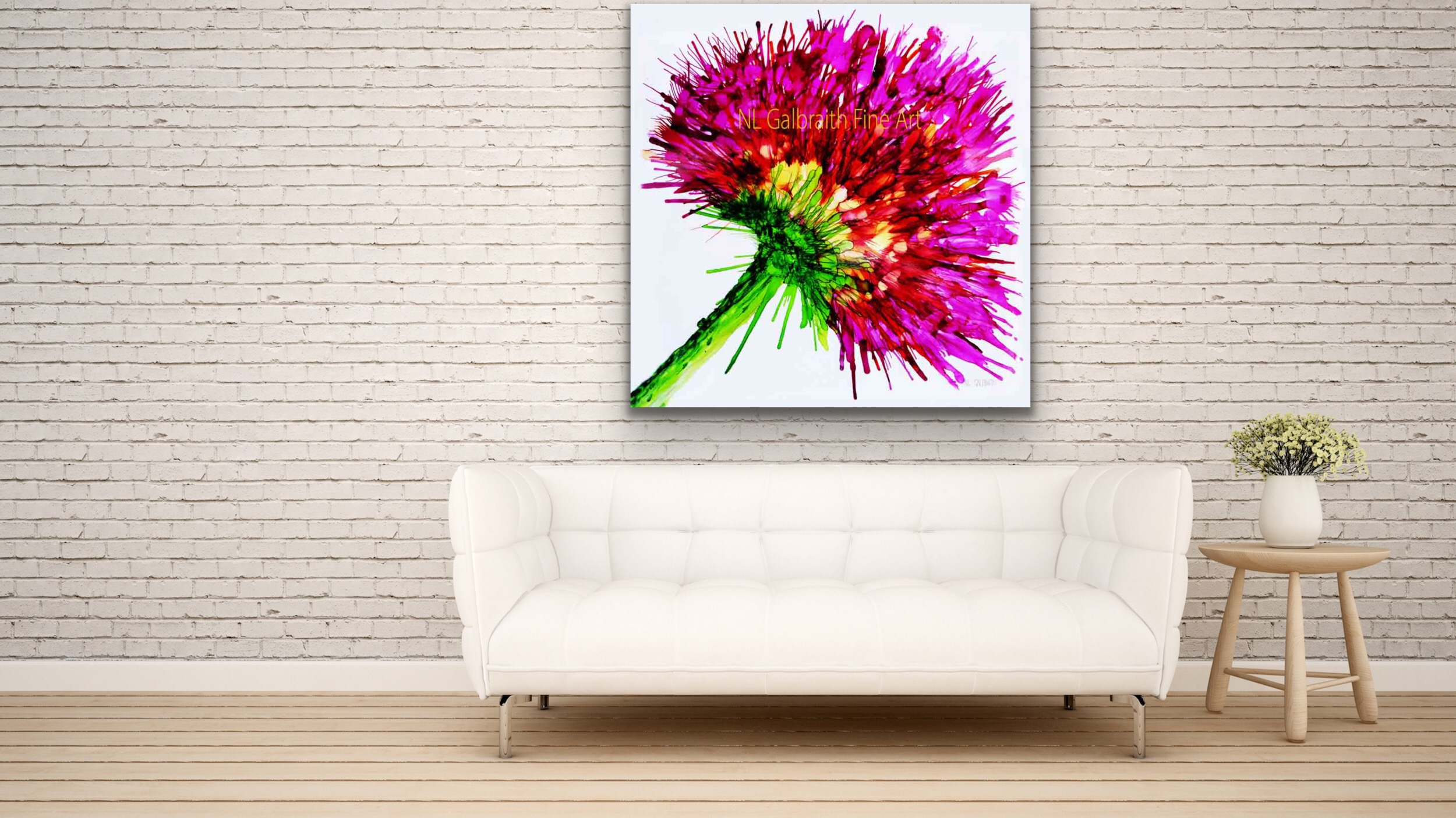 Oversized Pink Flower Graphic on a White Brick Wall Over a Sofa
