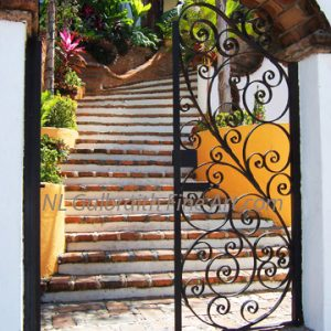 Elegant Curved Brick Staircase With Yellow Planters and  Wrought Iron Doors