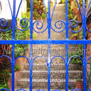 Mexican Cobblestone Stairs And A Blue Iron Gate